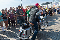 73 year-old artist, sculptor, photographer, and motorcycle-maniac Michael Gontesky of Virginia riding his 1911 Harley-Davidson 8A on the Atlantic City boardwalk at the start of the Motorcycle Cannonball Race of the Century. Stage-1 from Atlantic City, NJ to York, PA. USA. Saturday September 10, 2016. Photography ©2016 Michael Lichter.