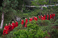 Circumambulating around the nunnery to pay respect to Khenpo Tsultrim Gyamtso Rinpoche who escaped from Tibet in 1968 and founded the nunnery - Karma Drubdey nunnery, Bhutan, 2016