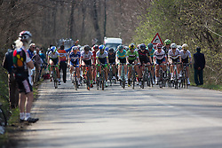 A large group of riders chase the lonely breakaway rider during the first, short loop of the Trofeo Alfredo Binda - a 123.3km road race from Gavirate to Cittiglio on March 20, 2016 in Varese, Italy.