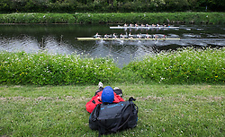 © Licensed to London News Pictures.13/06/15<br /> Durham, England<br /> <br /> A man relaxes on the grass and watches the rowing during the 182nd Durham Regatta rowing event held on the River Wear. The origins of the regatta date back  to commemorations marking victory at the Battle of Waterloo in 1815. This is the second oldest event of this type in the country and attracts over 2000 competitors from across the country.<br /> <br /> Photo credit : Ian Forsyth/LNP