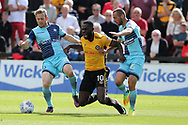 Frank Nouble of Newport County © falls as he is challenged by Craig Mackail-Smith (l) and Adam El-Abd of Wycombe Wanderers. .EFL Skybet football league two match, Newport county v Wycombe Wanderers at Rodney Parade in Newport, South Wales on Saturday 9th September 2017.<br /> pic by Andrew Orchard, Andrew Orchard sports photography.