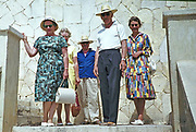 Group of British holidaymakers on holiday in Mediterranean standing on steps, 1966