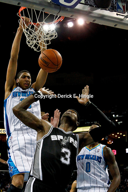October 31, 2012; New Orleans, LA, USA; New Orleans Hornets power forward Anthony Davis (23) dunks over San Antonio Spurs small forward Stephen Jackson (3) during the first half of a game at the New Orleans Arena. Mandatory Credit: Derick E. Hingle-US PRESSWIRE