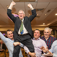 Michael Begley is lifted by his sons, Micheal, Roghan and Feilim after being elected in Shannon