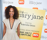 """Mara Brock Akil, creator and executive producer of  BET's """"Being Mary Jane"""", poses for a portrait before a screening  at the W Hotel in Dallas, Texas on June 22, 2013."""
