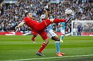 James Milner of Liverpool (l) gets to the ball ahead of Raheem Sterling of Manchester City. Capital One Cup Final, Liverpool v Manchester City at Wembley stadium in London, England on Sunday 28th Feb 2016. pic by Chris Stading, Andrew Orchard sports photography.