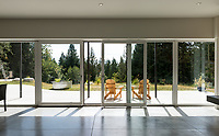 A concrete insulated panel (CIP) home built by NZ Builders of Victoria, BC is set on a forested hillside on the Sunshine Coast of BC.