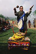 Electricity comes to the Bhutanese village of Shingkhey in 2001. A district dignitary participates in the celebration of the coming of electricity to Shingkhey Village, Bhutan. From coverage of revisit to Material World Project family in Bhutan, 2001.