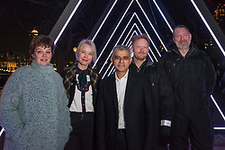"""© Licensed to London News Pictures. 17/01/2018. LONDON, UK. (L to R) Helen Marriage, Lumiere London Artistic Director, Justin Simmons, Deputy Mayor of Culture, Sadiq Khan, Mayor of London, Kasper Rasmussen, Vertigo artists stand in the  """"The Wave"""" by Vertigo which is unveiled on the South Bank.  Preview of  Lumiere London, the capital's largest arts festival commissioned by The Mayor of London and produced by Artichoke.  Light installations by leading artists have been set up, both north and south of the river.  Photo credit: Stephen Chung/LNP"""