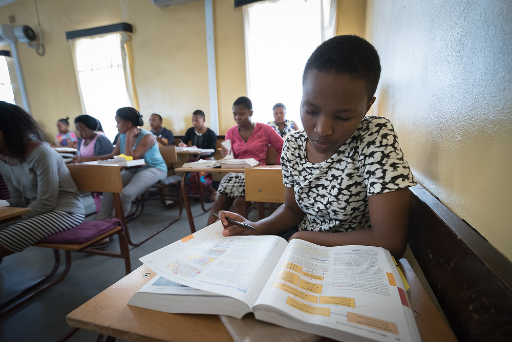 2 March 2017, Ma Mafefooane Valley, Lesotho: Kamohelo Khoarai is a first-year student in the general nursing programme. Here, during anatomy class, as part of a course in Anatomy and physiology for first-year students in the general nursing programme. This lesson is on the neural system. The class consists of 31 students, both men and women, and is in its second semester. The Roma College of Nursing is a Roman Catholic non-profic institution under the Christian Health Association of Lesotho. The college educates nurses and midwives, and is situated adjacent to Saint Joseph's Hospital in the Ha Mafefooane Valley, some 35 kilometers from Lesotho's capital, Maseru. The school forms an integral part of Saint Joseph's Hospital, where the students acquire essential parts of their hands-on training. The school was founded in 1972, and is open to candidates of any gender and various religious backgrounds. Applications are also open to students from other countries. Most students begin their studies at the age of 19-20. Most are from Lesotho, but some are international. The college hosts a total of some 120 students. Four out of five are women. Through sponsorship from ICAP and the Nursing Education Partnership Initiative (NEPI), which draws funds from PEPFAR, the school maintains a library and a skills laboratory specifically designed to improve nursing education in Lesotho. There are six nursing training institutions in Lesotho in total, of which four are denominational as part of the Christian Health Association of Lesotho, and thus owned by the churches. Two institutions are public, run by the government.
