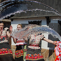 Boys throw water at girls as part of traditional Easter celebrations, during a media presentation in Mezokovesd, Hungary on April 5, 2012. ATTILA VOLGYI
