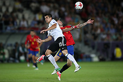 Germany's Marc-Oliver Kempf (left) and Spain's Niguez Saul battle for the ball