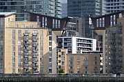 Thames riverside residential and office properties at Canary Wharf in London Docklands, on 16th September 2021, in London, England. Canary Wharf was once a thriving Victorian cargo dock but after Thames shipping declined from the 1960s, its derelict areas were redeveloped in the 19080 by Margaret Thatchers Docklands Development Corporation created one of the UK's main financial centres, now home to the European Headquarters of numerous major banks including Barclays, Credit Suisse and HSBC.