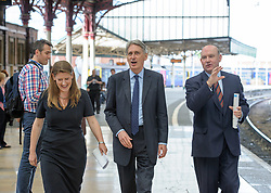 © Licensed to London News Pictures.  30/05/2017; Bristol, UK. General Election 2017; THEO CLARKE (female) the Bristol East Conservative candidate, PHILIP HAMMOND, Chancellor of the Exchequer, and TIM BOWLES West of England Combined Authority elected mayor, visit Bristol Temple Meads railway station. Picture credit : Simon Chapman/LNP