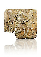 Picture & image of Hittite relief sculpted orthostat stone panel of Herald's Wall Limestone, Karkamıs, (Kargamıs), Carchemish (Karkemish), 900-700 B.C. Anatolian Civilisations Museum, Ankara, Turkey.<br /> <br /> This relief tells the story the killing of Humbaba, protective deity of the cedar forests, by Gilgamesh and Enkidu. The figures standing on both sides hold, with one hand, the arms of the figure in the middle transversally while they stab the dagger on the head of the figure.  <br /> <br /> Against a white background. .<br />  <br /> If you prefer to buy from our ALAMY STOCK LIBRARY page at https://www.alamy.com/portfolio/paul-williams-funkystock/hittite-art-antiquities.html  - Type  Karkamıs in LOWER SEARCH WITHIN GALLERY box. Refine search by adding background colour, place, museum etc<br /> <br /> Visit our HITTITE PHOTO COLLECTIONS for more photos to download or buy as wall art prints https://funkystock.photoshelter.com/gallery-collection/The-Hittites-Art-Artefacts-Antiquities-Historic-Sites-Pictures-Images-of/C0000NUBSMhSc3Oo