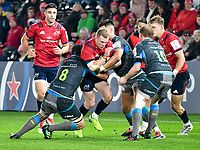 Rugby Union - 2019 / 2020 Champions Cup: Ospreys vs. Munster<br /> <br /> Keith Earls of Munster tackled by Morgan Morris of Ospreys, at The Liberty Stadium.<br /> <br /> COLORSPORT/WINSTON BYNORTH