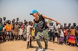 "Cara Delevingne releases a photo on Instagram with the following caption: ""I\u2019ll never forget my experience traveling to Uganda with @GirlUpCampaign and @Refugees meeting the refugee girls who feared having to get married at 13 because they couldn\u2019t afford the books, supplies, and uniforms to go to school. Today on #GivingTuesday, I\u2019m inspired by their strength and the power of @GirlUpCampaign\u2019s incredible Club leaders around the world who are fundraising to help give girls in Uganda a chance to stay in school and decide their own futures. Join me and donate by clicking on the link in my bio"". Photo Credit: Instagram *** No USA Distribution *** For Editorial Use Only *** Not to be Published in Books or Photo Books ***  Please note: Fees charged by the agency are for the agency's services only, and do not, nor are they intended to, convey to the user any ownership of Copyright or License in the material. The agency does not claim any ownership including but not limited to Copyright or License in the attached material. By publishing this material you expressly agree to indemnify and to hold the agency and its directors, shareholders and employees harmless from any loss, claims, damages, demands, expenses (including legal fees), or any causes of action or allegation against the agency arising out of or connected in any way with publication of the material."