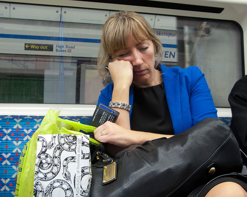 Portrait of a tired female on the London Underground Network
