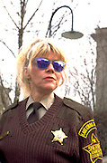 Ramsey county sheriff age 44 officiating at the St Patricks Day parade.  St Paul  Minnesota USA