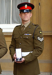 """File photo dated 27/4/2005 of Corporal Brian Wood with his Military Cross at Buckingham Palace, London. The decorated Iraq War veteran has said false claims of murder and torture against the Army had """"tarnished"""" the bravery he and his men showed on the battlefield."""