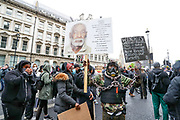 People hold placards in London, Saturday, June 6, 2020, during a rally to protest against the killing of George Floyd by police officers in Minneapolis, USA. Floyd, a black man, died after he was restrained by Minneapolis police while in custody on May 25 in Minnesota. (Photo/ Vudi Xhymshiti)