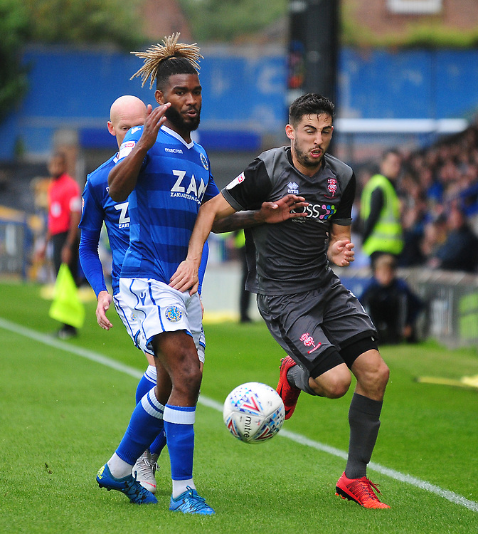 Lincoln City's Tom Pett vies for possession with Macclesfield Town's Tyrone Marsh<br /> <br /> Photographer Andrew Vaughan/CameraSport<br /> <br /> The EFL Sky Bet League One - Macclesfield Town v Lincoln City - Saturday 15th September 2018 - Moss Rose - Macclesfield<br /> <br /> World Copyright © 2018 CameraSport. All rights reserved. 43 Linden Ave. Countesthorpe. Leicester. England. LE8 5PG - Tel: +44 (0) 116 277 4147 - admin@camerasport.com - www.camerasport.com