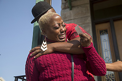 September 10, 2017 - Chicago, IL, USA - Tereasa Martin, mother of Kenneka Jenkins, is comforted by her boyfriend as she speaks about her daughter's death outside her home on Sunday, Sept. 10, 2017, in Chicago, Ill. (Credit Image: © Alyssa Pointer/TNS via ZUMA Wire)