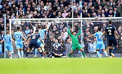 Burnley's Chris Wood sees his shot hit the top of the post during the Premier League match at the Etihad Stadium, Manchester. Picture date: Saturday October 16, 2021.