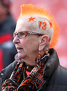 A Cleveland Browns fan sports orange spiked hair and the number 73 on her head as she looks on during the Cleveland Browns NFL week 9 regular season football game against the Tampa Bay Buccaneers on Sunday, Nov. 2, 2014 in Cleveland. The Browns won the game 22-17. ©Paul Anthony Spinelli