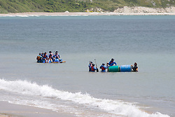 © London News Pictures. United Kingdom, Swanage : An activates group launch water raft on the sea on a sunny day in Swanage, Dorset, on June 3, 2015. Photo credit: LNP