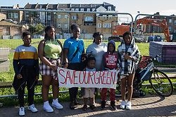 London, UK. 14th August, 2021. Southwark residents protest alongside Peckham Green against plans by Southwark Council to develop it as public housing. Peckham Green, also known as Jocelyn Street Park, is a 1.4-acre public park off Peckham High Street, one of the most polluted roads in London, in a borough which is ranked fifth-worst in London and eighth-worst in the UK for easy access to green space.