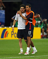 Photo: Chris Ratcliffe.<br /> England v Portugal. Quarter Finals, FIFA World Cup 2006. 01/07/2006.<br /> Gutted Owen Hargreaves with Jermaine Jenas.