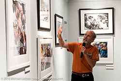 Michael Lichter talks about his photographic prints in the Naked Truth exhibition's industry party at the Buffalo Chip gallery during the 75th Annual Sturgis Black Hills Motorcycle Rally.  SD, USA.  August 5, 2015.  Photography ©2015 Michael Lichter.