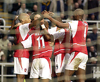 Photo. Jed Wee<br />Newcastle United v Arsenal, FA Barclaycard Premiership, St. James' Park, Newcastle. 09/02/2003.<br />Arsenal players gather around to celebrate Thierry Henry (L)'s opening goal.