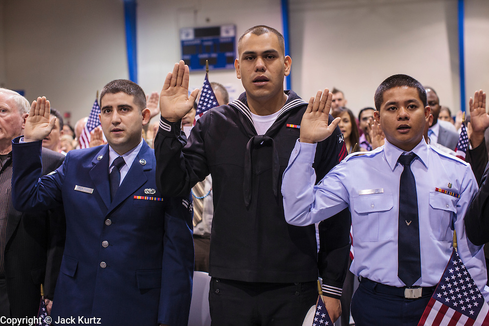 04 JULY 2012 - PHOENIX, AZ:   Current and former members of the US military are naturalized as US citizens in Phoenix Wednesday. About 250 people, from 62 countries, were naturalized as US citizens during the 24th Annual Fiesta of Independence naturization ceremony at South Mountain Community College in Phoenix Wednesday. The ceremony was presided over by the Honorable Roslyn O. Silver, Chief United States District Court Judge.  PHOTO BY JACK KURTZ
