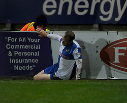 Bristol Rovers' David Clarkson gets his foot caught in the advertising board, and gets it out with the help of stewards - Photo mandatory by-line: Dougie Allward/JMP - Tel: Mobile: 07966 386802 14/12/2013 - SPORT - Football - Morecombe - Globe Arena - Morecombe v Bristol Rovers - Sky Bet League Two