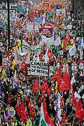Peaceful demonstration along Piccadilly in central London by protesters during the TUC union march against cuts on 26th March 2011 in London, United Kingdom. Around 400,000 people joined the TUC's March for the Alternative to oppose the coalition government's spending cuts. Teachers, nurses, midwives, NHS, council and other public sector workers were joined by students and pensioners to bring the centre of the capital to a standstill and to make their point that the current coalition government is making cuts too fast which they suggest will have a catastrophic effect on jobs and economic recovery.