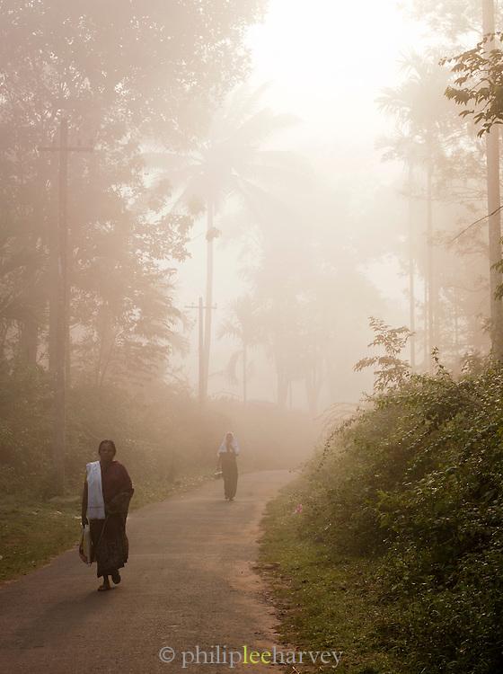 People walking along quiet back roads near Wayanad, Kerala, India