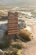 Sign and rocks on path, Plateau de Coscione, Corsica, France
