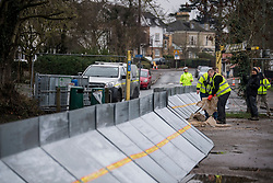 © Licensed to London News Pictures. 01/02/2021. Weybridge, UK. Workers installing flood defences along the river Thames at Weybridge in Surrey. Extra precaution is being taken because In 2014 Weybridge and the surrounding area was badly hit by flooding. Photo credit: Ben Cawthra/LNP