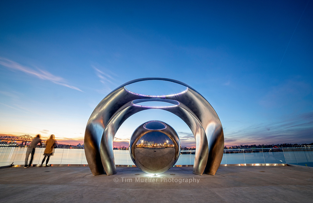 A sculpture similar to the bean sculpture in Chicago rest atop the Mississippi River levee in Baton Rouge, La. The 14-foot-tall sculpture, by San Francisco-based artist Po Shu Wang, was commissioned by the Baton Rouge Rotary Club to mark their centennial celebration. The sculpture consists of three stainless steel reflective spheres nestled within each other.