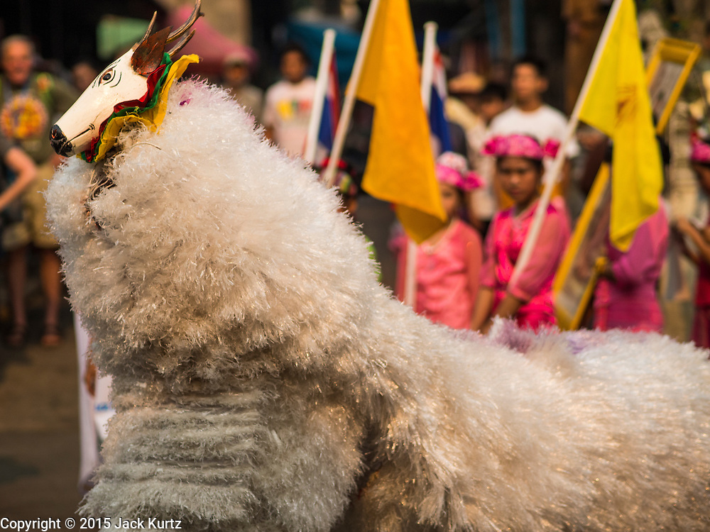 """05 APRIL 2015 - CHIANG MAI, CHIANG MAI, THAILAND:  A traditional Tai Yai dance with a deer during the second day of the three day long Poi Song Long Festival in Chiang Mai. The Poi Sang Long Festival (also called Poy Sang Long) is an ordination ceremony for Tai (also and commonly called Shan, though they prefer Tai) boys in the Shan State of Myanmar (Burma) and in Shan communities in western Thailand. Most Tai boys go into the monastery as novice monks at some point between the ages of seven and fourteen. This year seven boys were ordained at the Poi Sang Long ceremony at Wat Pa Pao in Chiang Mai. Poy Song Long is Tai (Shan) for """"Festival of the Jewel (or Crystal) Sons.   PHOTO BY JACK KURTZ"""