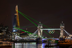 © licensed to London News Pictures. London, UK 05/07/2012. A laser show illuminates the sky to mark the unveiling of the Shard, Europe's tallest building in central London. Photo credit: Tolga Akmen/LNP