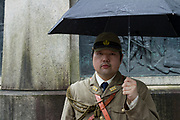 A Japanese man,  in Imperial Army uniform, holds an umbrella as Yasukuni shrine marks the 72nd anniversary of the end of the Pacific War. Yasukuni Shrine, Kudanshita, Tokyo Japan. Tuesday August 15th 2017. Nominally a event to honour Japan's war dead and call for continued peace, this annual gathering  at Tokyo's controversial Yasukuni  Shine also allows many Japanese nationalists to display their nostalgia for their Imperial past.Rightwing paramilitary groups, Imperial cos-players, politicians and many ordinary citizens come together at the shrine to march and wave flags. The day goes almost unreported in the mainstream Japanese media.