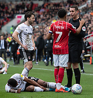 Bristol City's Korey Smith (centre) and Fulham's Harry Arter (left) discussing a foul on Fulham's Ivan Cavaleiro (injured on the ground) with referee  David Coote (right) <br /> <br /> Photographer David Horton/CameraSport<br /> <br /> The EFL Sky Bet Championship - Bristol City v Fulham - Saturday 7th March 2020 - Ashton Gate Stadium - Bristol<br /> <br /> World Copyright © 2020 CameraSport. All rights reserved. 43 Linden Ave. Countesthorpe. Leicester. England. LE8 5PG - Tel: +44 (0) 116 277 4147 - admin@camerasport.com - www.camerasport.com