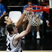 Efes Pilsen's Kerem GONLUM (B) during their Turkish Basketball league derby match Besiktas between Efes Pilsen at the BJK Akatlar Arena in Istanbul Turkey on Saturday 30 April 2011. Photo by TURKPIX