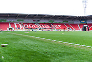 A general view of the away end at the Keepmoat Stadium whilst two Doncaster players warm up before the The FA Cup fourth round match between Doncaster Rovers and Oldham Athletic at the Keepmoat Stadium, Doncaster, England on 26 January 2019.
