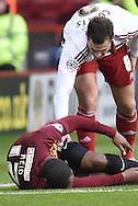 Kyel Reid of Bradford City sustains injury during the Sky Bet League 1 match between Sheffield Utd and Bradford City at Bramall Lane, Sheffield, England on 28 December 2015. Photo by Ian Lyall.