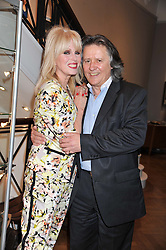JOANNA LUMLEY and her husband STEPHEN BARLOW at a reception to unveil the Limited Centenary Edition of Sir George Frampton's statuette of Peter Pan in aid of the Moat Brae Charity held at The Fine Art Society, 148 New Bond Street, London on 1st May 2012.