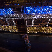 BUDAPEST, HUNGARY - DECEMBER 07:  Two women walk in front of the traditional spcial festive Christmas lit Tram n2  on December 7, 2017 in Budapest, Hungary. The traditional Christmas market and lights will stay until 31st December 2017.